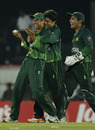 Pakistan's fielders celebrate a run-out