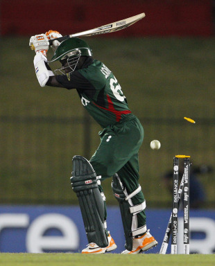 Shem Ngoche is bowled by Umar Gul, Kenya v Pakistan, World Cup, Group A, Hambantota, February 23, 2011