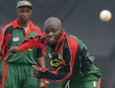 Kenya's Shem Ngoche bowls during a training session at the P Sara Oval, Colombo, February 26, 2011