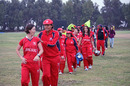 Neisha Pratt leads the victorious Hong Kong team off the field after beating China in the ACC Women's Twenty20 final in Kuwait on 25th February 2011