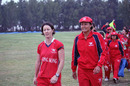 Champions - Neisha Pratt and Connie Wong lead the victorious Hong Kong team off the field after beating China by three wickets in the ACC Women's Twenty20 final in Kuwait on 25th February 2011