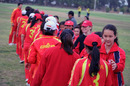 Mariko Hill and the rest of the Hong Kong players shake hands with their Chinese counterparts at the conclusion of the ACC Women's Twenty20 final in Kuwait on 25th February 2011