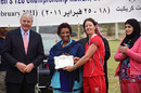 Neisha Pratt received her Player of the Match award from former British RM John Major and Sheikha Naeema Al-Ahmed Al Sabah, Head of Women's Cricket in Kuwait following Hong Kong's three wicket victory over China in the final of the ACC Women's Twenty20 Championships 2011 played in Kuwait on 25th February 2011