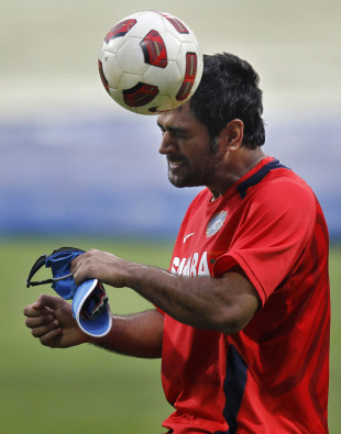 MS Dhoni warms up during practice with a game of football, Bangalore, February 26, 2011