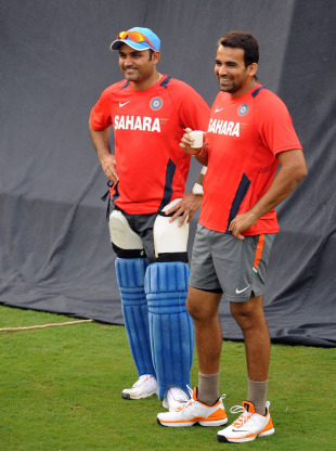 Virender Sehwag and Zaheer Khan watch their team-mates practice, Bangalore, February 26, 2011
