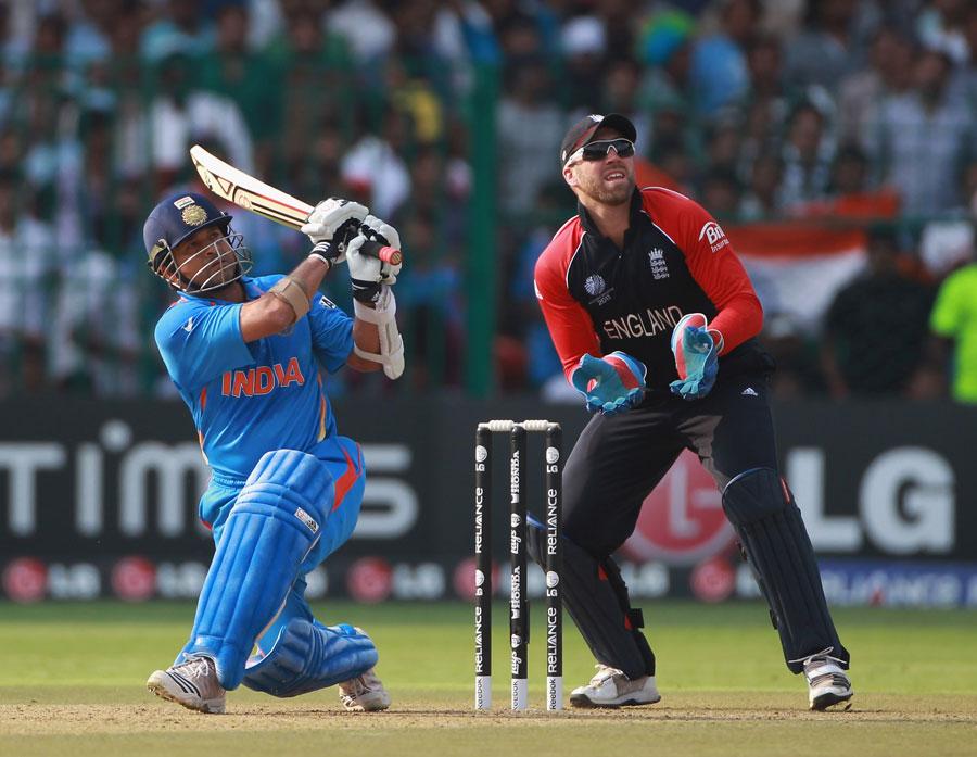 Sachin Tendulkar sends the ball into the stands during his 103-ball century
