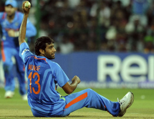 Munaf Patel took a clever return catch to dismiss Kevin Pietersen, World Cup, Group B, Bangalore, February 27, 2011