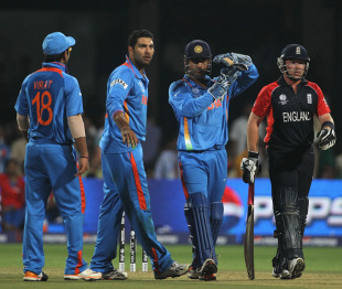 MS Dhoni calls for a referral when Ian Bell was struck on the pads by Yuvraj Singh, India v England, World Cup, Group B, Bangalore, February 27, 2011