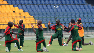 Kenya players stretch during practice