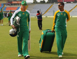 Johan Botha and Robin Peterson head for a net session, World Cup, Mohali, March 1, 2011