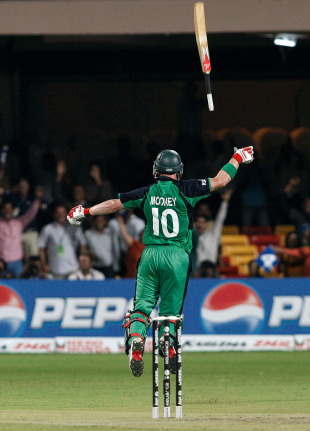 John Mooney flings his bat in the air after securing a dream result with a boundary, England v Ireland, World Cup 2011, Bangalore, March 2, 2011