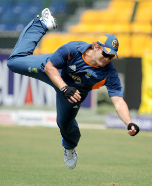 Shane Watson leaps during Australia's fielding practice, Colombo, March 4, 2011