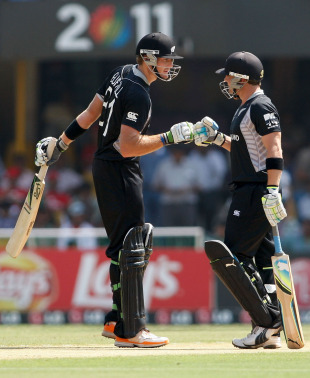 Martin Guptill and Brendon McCullum have a chat during their half-century partnership, New Zealand v Zimbabwe, Group A, World Cup 2011, Motera, March 4, 2011
