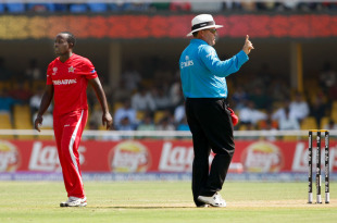 Umpire Marais Erasmus hands out a warning to Prosper Utseya after he bowled a beamer, New Zealand v Zimbabwe, Group A, World Cup 2011, Motera, March 4, 2011