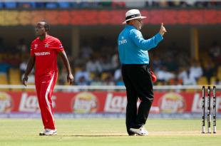 Umpire Marais Erasmus hands out a warning to Prosper Utseya after he bowled a beamer, New Zealand v Zimbabwe, Group A, World Cup 2011, Motera, March 4, 2011