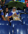 Fans take refuge from the rain, Sri Lanka v Australia, Group A, World Cup 2011, Colombo, March 5, 2011