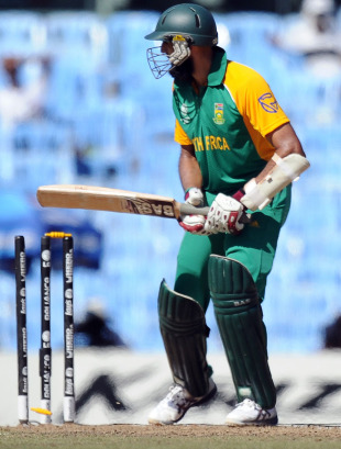 Hashim Amla looks back at his broken stumps after being bowled by Stuart Broad, England v South Africa, Group B, World Cup, Chennai, March 6, 2011