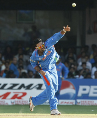 Yuvraj Singh sends down a flighted one, India v Ireland, Group B, World Cup 2011, Bangalore, March 6, 2011