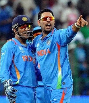 Yuvraj Singh celebrates his five-wicket haul with MS Dhoni, India v Ireland, Group B, World Cup 2011, Bangalore, March 6, 2011