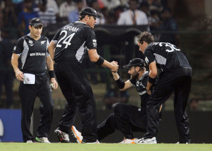 Daniel Vettori is helped up by his team-mates after hurting his knee, New Zealand v Pakistan, Group A, World Cup, Pallekele, March 8, 2011