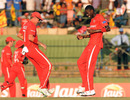 Ray Price and Chris Mpofu celebrate Upul Tharanga's dismissal