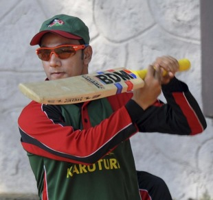 Tanmay Mishra checks his bat during a training session, Bangalore, March 10, 2011