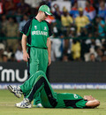 Trent Johnston goes down with a knee injury, India v Ireland, Group B, World Cup 2011, Bangalore, March 6, 2011