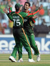 Shakib Al Hasan and Mahmudullah celebrate the dismissal of Ian Bell