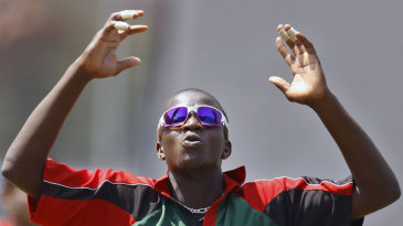Kenya's James Ngoche reacts after bowling in the nets