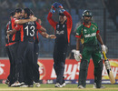 Ajmal Shahzad is congratulated by team-mates after dismissing Naeem Islam
