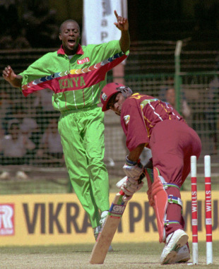 Martin Suji bowls Sherwin Campbell for 4, Kenya v West Indies, World Cup, Pune, February 29, 1996