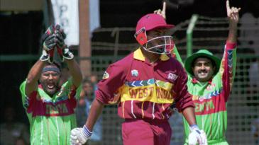 Wicketkeeper Tariq Iqbal and  Aasif Karim celebrate as Brian Lara is caught behind