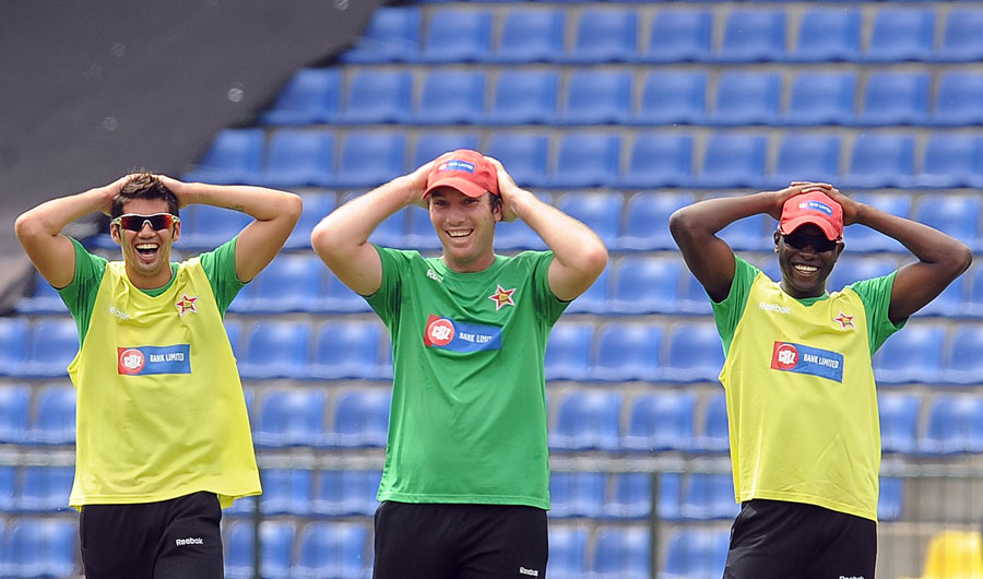 Graeme Cremer, Brendan Taylor and Elton Chigumbura have some fun during practice