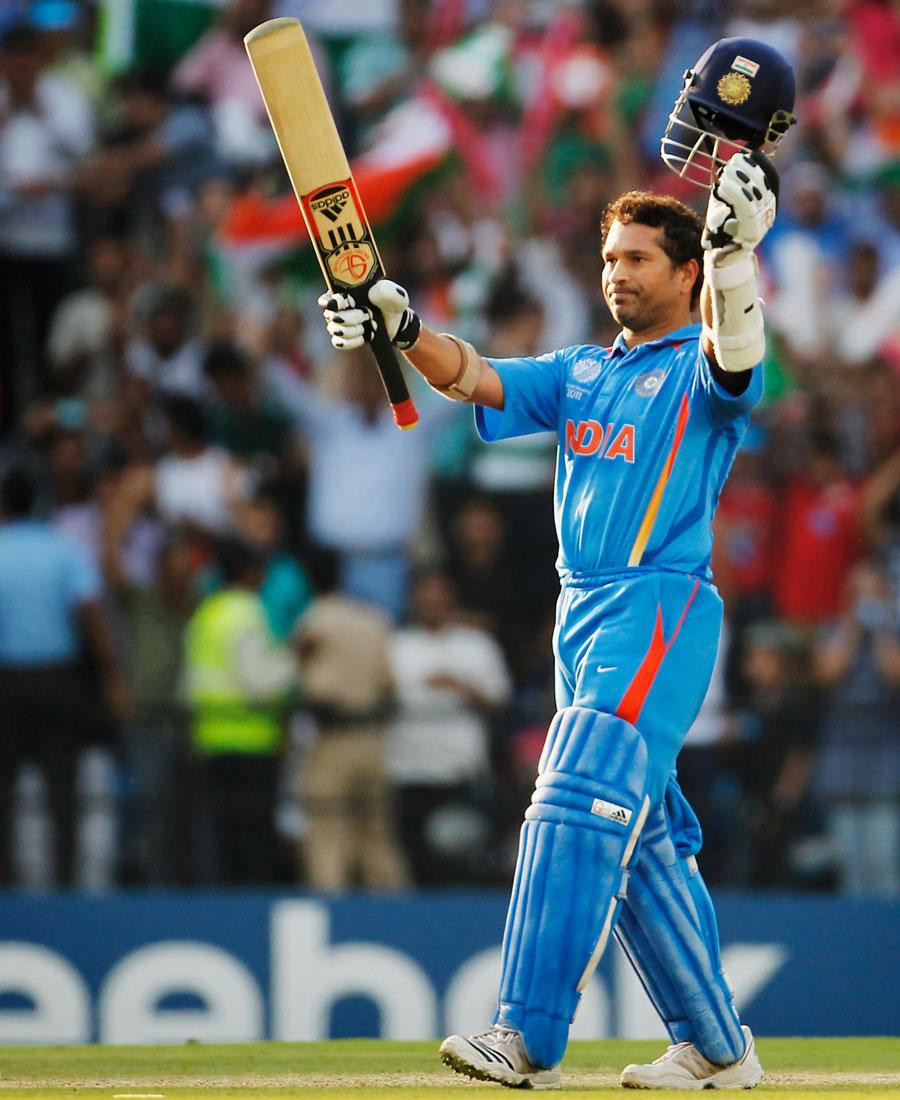 Sachin Tendulkar acknowledges the cheers after his 92-ball century ...