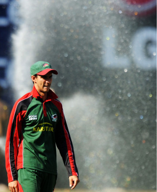 Seren Waters looks on during Kenya's practice session as the outfield is watered, Bangalore, March 12, 2011
