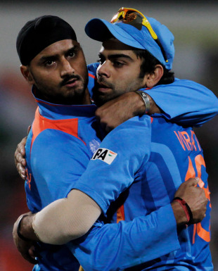 Harbhajan Singh and Virat Kohli embrace after combining to dismiss AB de Villiers, India v South Africa, Group B, World Cup, Nagpur, March 12, 2011