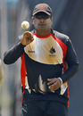 Balaji Rao gets ready to bowl during Canada's training session, Bangalore, March 15, 2011