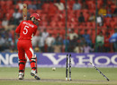 Karl Whatham looks back to see his stumps destroyed by Brett Lee, Australia v Canada, Group A, World Cup, Bangalore, March 16, 2011