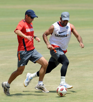 Gary Kirsten takes on MS Dhoni during a warm-up game of football, Chennai, March 18, 2011