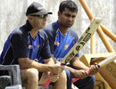 Coach Jamie Siddons and Tamim Iqbal inspect bats during a training session, Mirpur, March 18, 2011