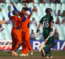 Tom Cooper and Atse Buurman celebrate William Porterfield's dismissal, Ireland v Netherlands, World Cup 2011, Group B, March 18, 2011