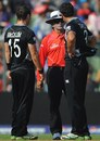 Ross Taylor and Nathan McCullum speak with umpire Asad Rauf