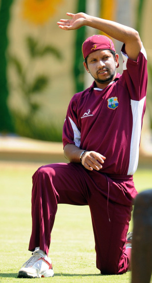 Ramnaresh Sarwan loosens up during a training session, Chennai, March 19, 2011
