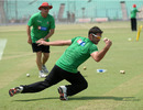 Greg Lamb is put through the paces during fielding practice, Kolkata, March 19, 2011