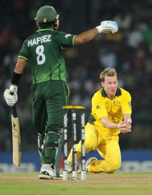 Mohammad Hafeez watches his leading edge back loop back to Brett Lee, Australia v Pakistan, Group A, World Cup 2011, Colombo, March 19, 2011