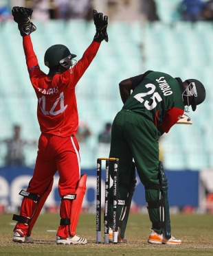 Steve Tikolo is lbw for 10 in his final innings, Kenya v Zimbabwe, Group A, World Cup 2011, Kolkata, March 20, 2011