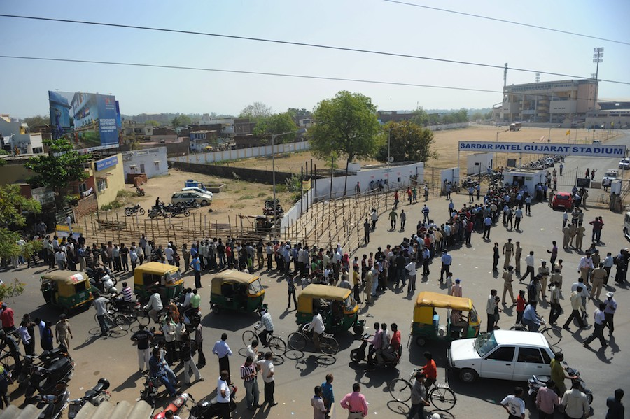 People queue up outside Motera to buy tickets for India's quarter-final