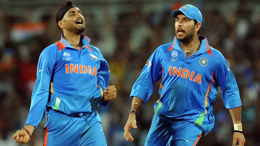 Harbhajan Singh and Yuvraj Singh celebrate the wicket of Kieron Pollard