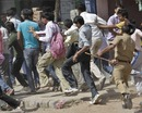 Police chase away fans who were unhappy at not obtaining tickets despite a long wait, Ahmedabad, March 21, 2010