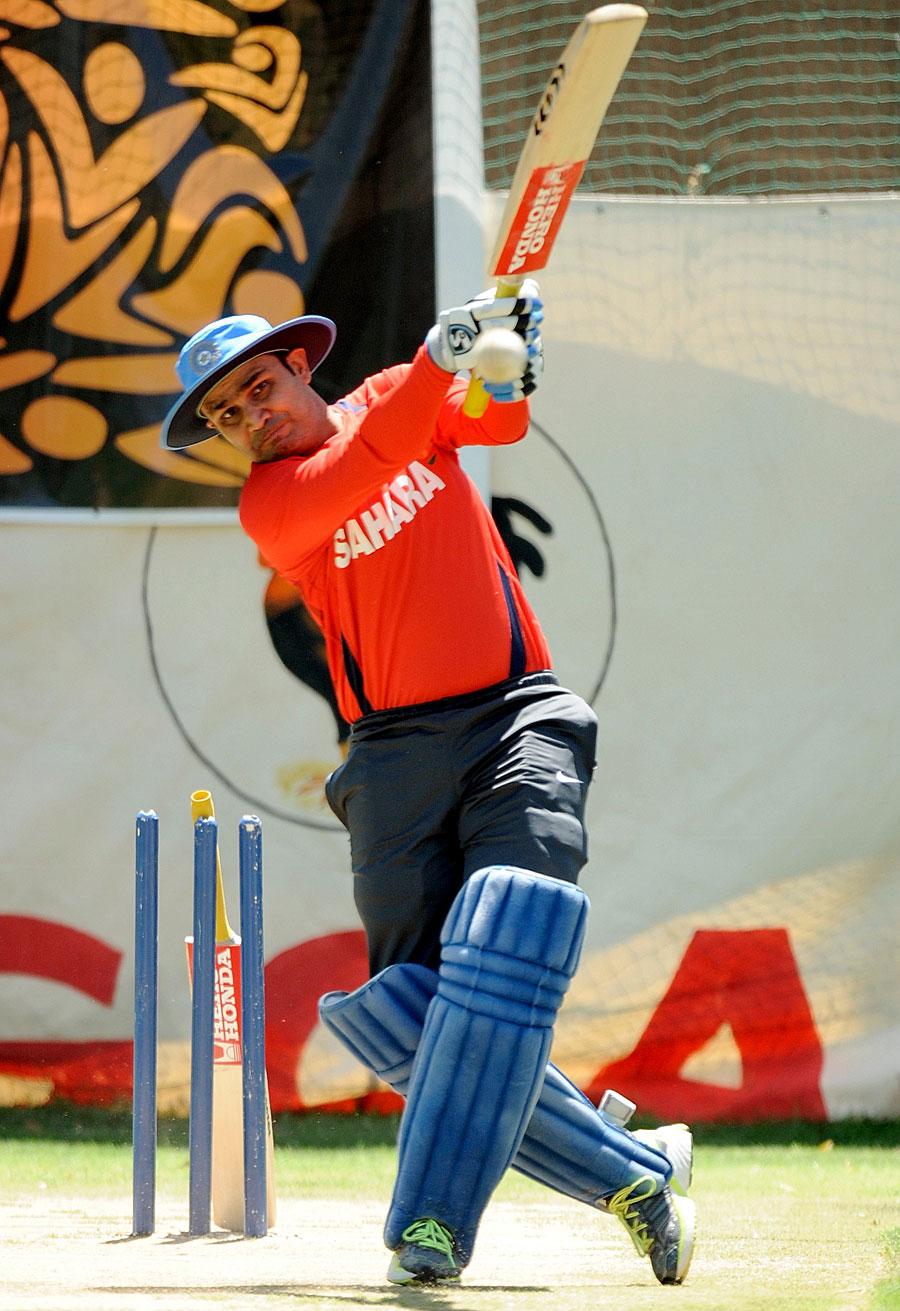 Virender Sehwag unleashes a big shot in the nets